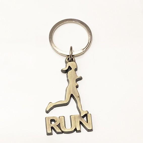 Chaveiro corredora run dourado envelhecido