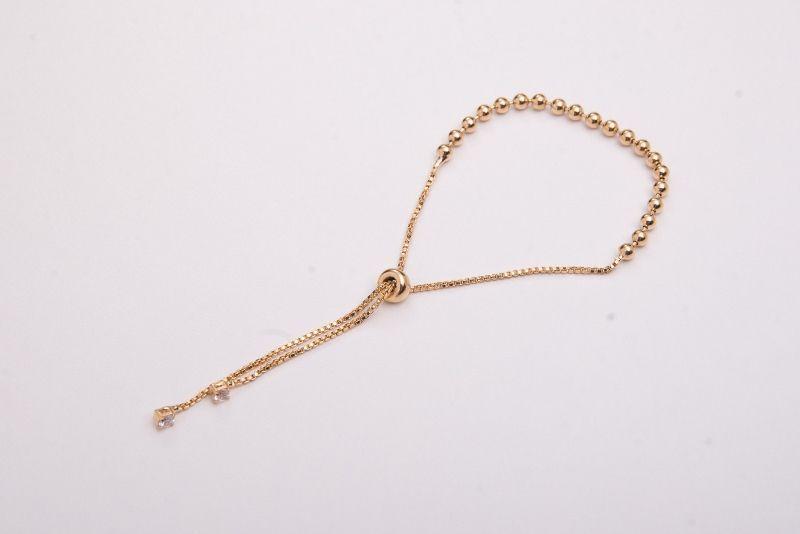 Pulseira semi jóia bolinhas pequena dourada