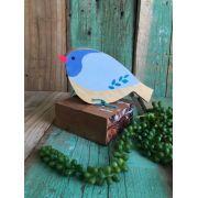 Pássaro em madeira azul com carimbo