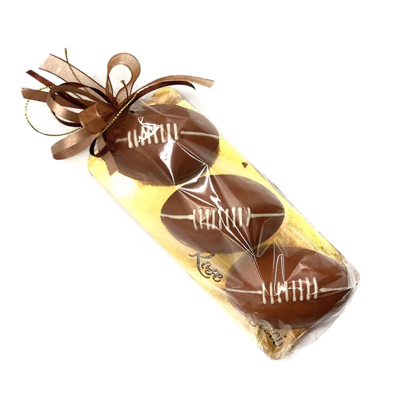 Bolas de futebol americano de chocolate ao leite