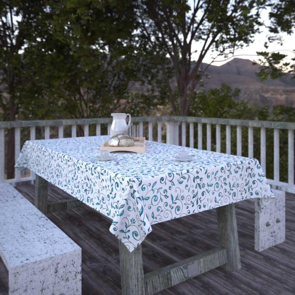 toalha de mesa branca com folhas verdes