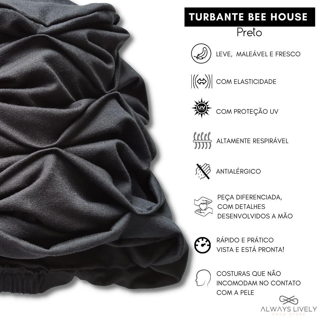 Turbante na cor preta em tecido modal liso com detalhes de pontos feitos a mão sobre o tecido dando relevo e volume a peça