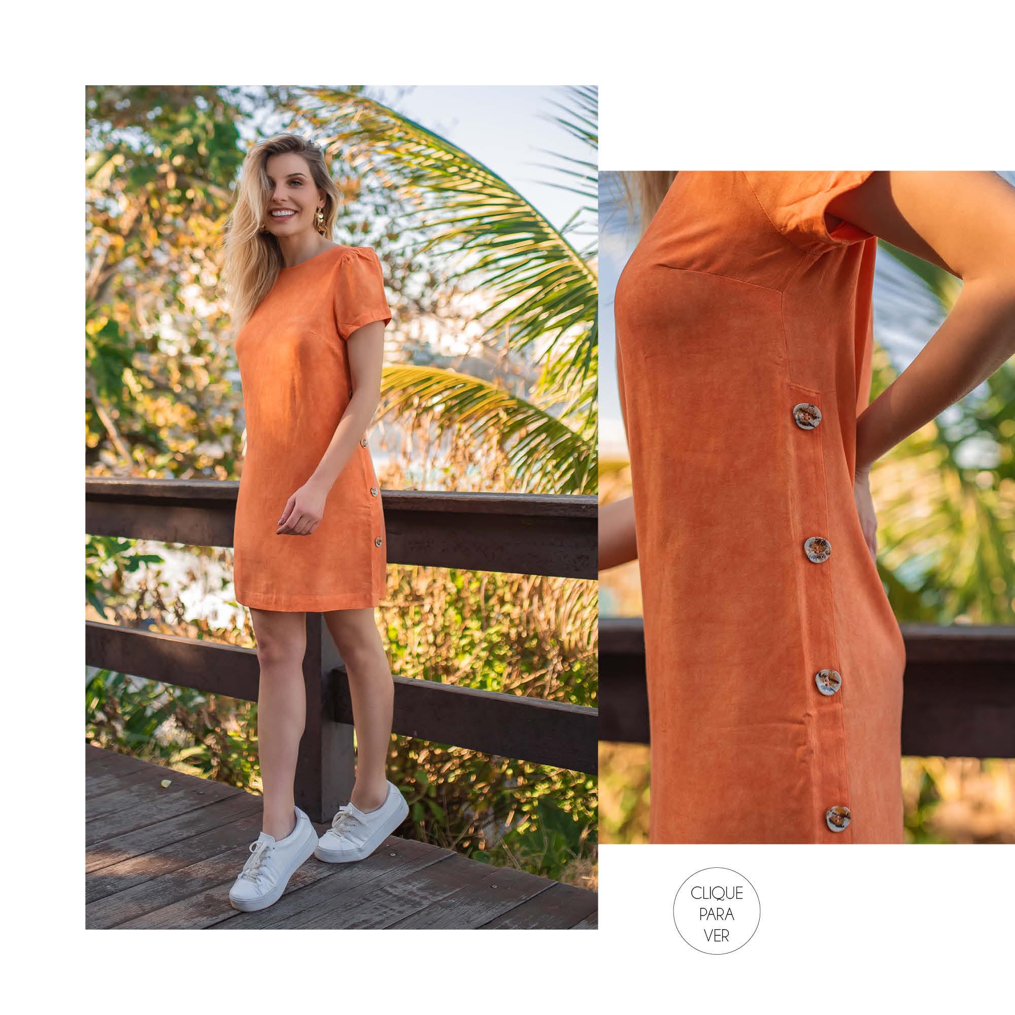 Manga bufante, detalhes em botões e um corte reto compõem o vestido cool perfeito.