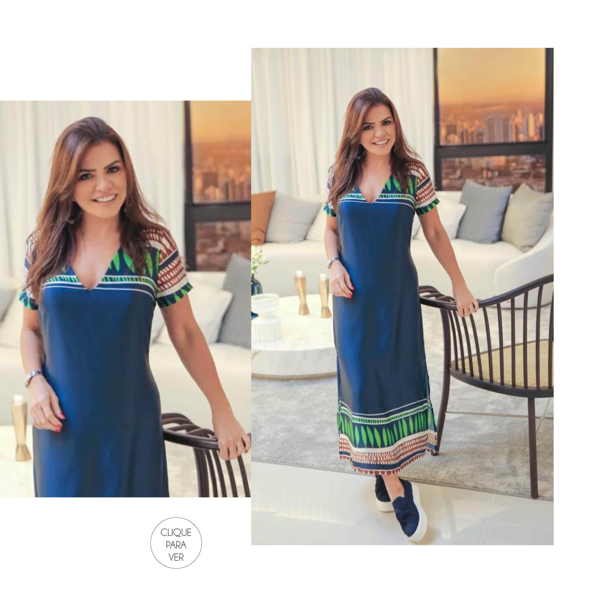 Vestido midi azul com textura leve de seda.