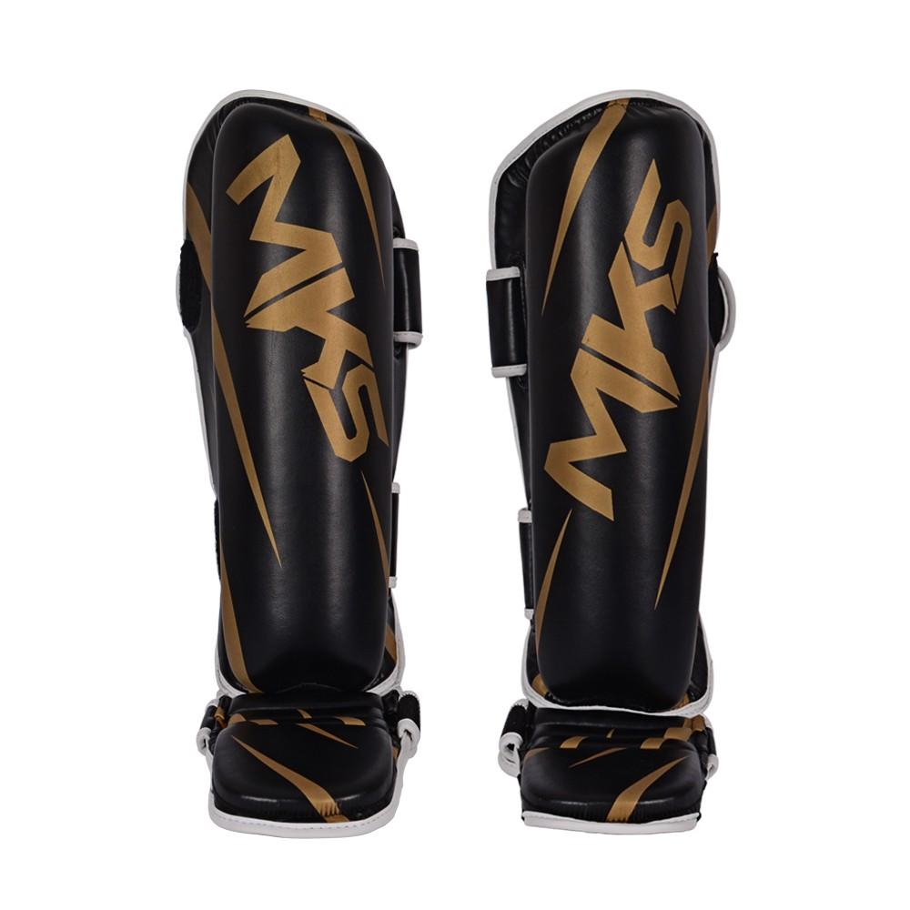 Caneleira de Muay Thai e Kickboxing MKS Champions V3 Preto/Dourado