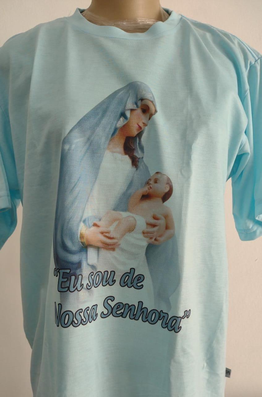 CA34 - Camiseta Poliester Branca Eu Sou de Nossa Senhora  - VindVedShop - Distribuidora Catolica