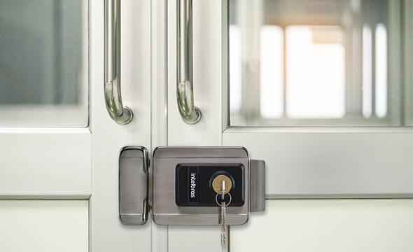 Fechadura elétrica de sobrepor com botoeira e chave intelbras FX 2000 INOX - JS Soluções em Segurança