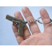 Chaveiro Pistola Metal Gun Vintage Dourada Sp440
