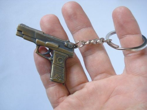 Chaveiro Pistola Metal Gun Vintage Dourada Sp440  - Presente Presente