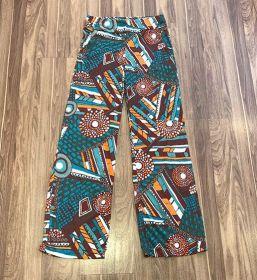 Calça pantalona em malha fria com bolsos - estampada laranja e marrom