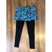 Legging de compressão preta com saia embutida estampa pincel azul