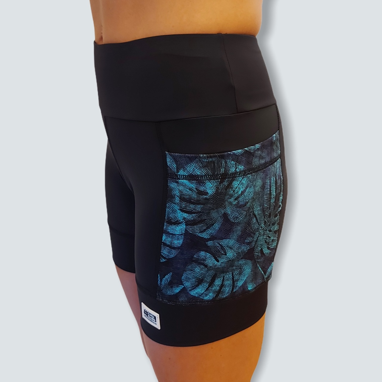 Shorts de compressão 2 bolsos laterais Square em compress preto bolsos estampa folhagem