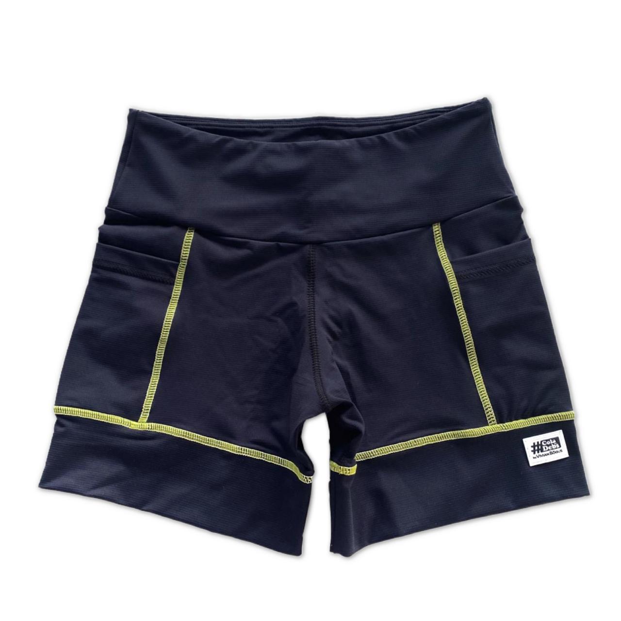 Shorts de compressão square em compress preto com costura amarela  - Vivian Bógus