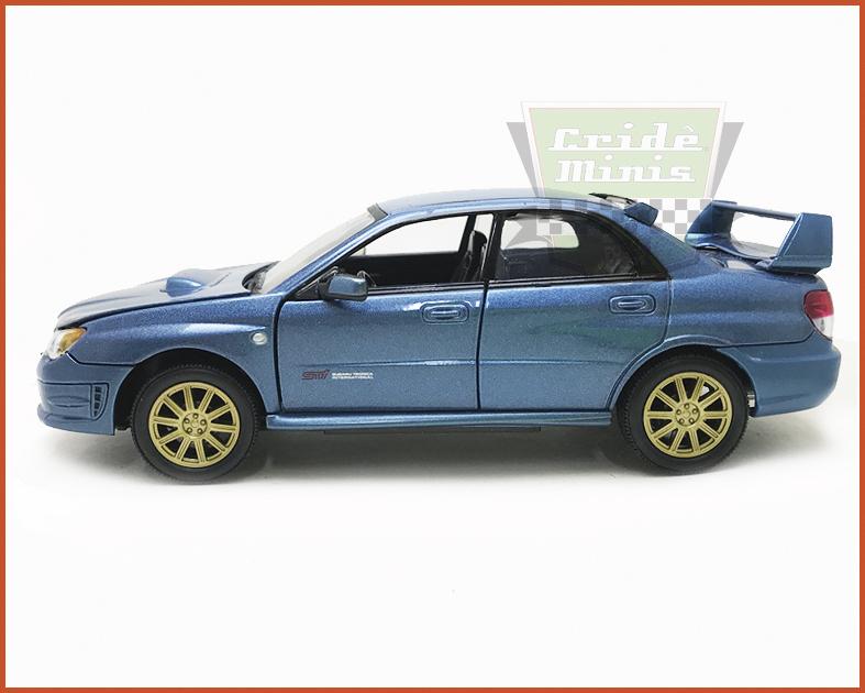 Subaru Impreza 2006 azul dobra os espelhos - Escala 1/24