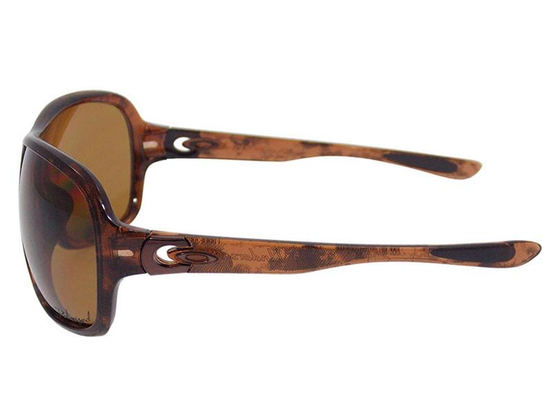 e10125aa2fda7 Óculos De Sol Oakley Feminino Underspin Polarizado OO9166 06. Image  description Image description Image description