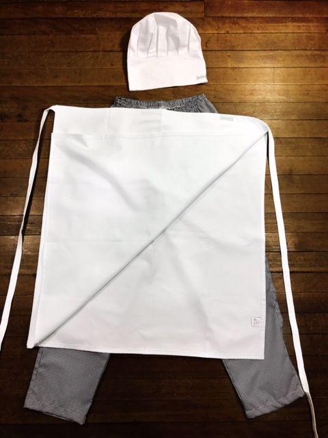 Conjunto UNIASSELVI Dólmã Clássica Manga 3/4 Botões VIVO Pretos 100% algodão branca bordada nome e logo + avental 4 Frentes branco 100% algodão + Calça com elástico total pied poule + chapéu chef bra