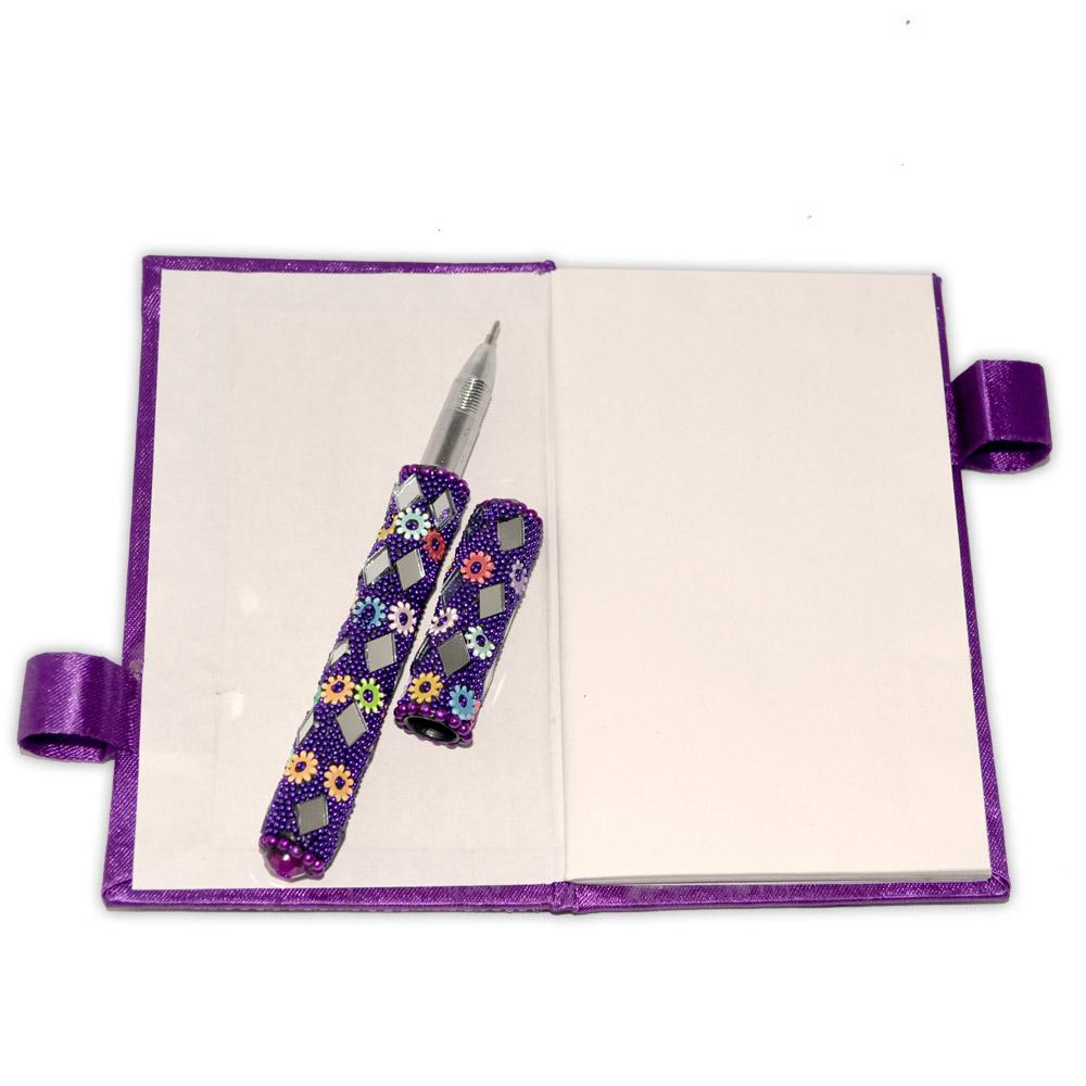 Caderno de Anotações roxo com caneta