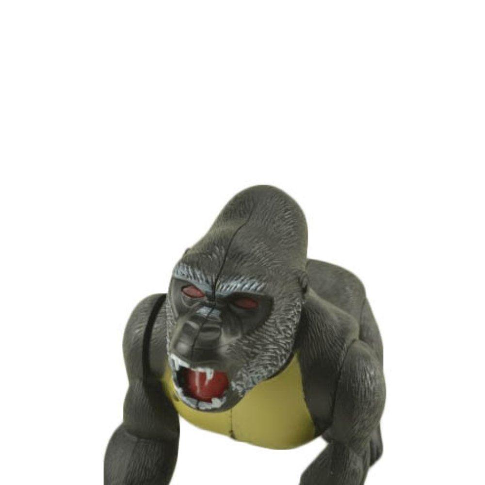gorila de brinquedo com luzes movimento e som a pilha 19cm