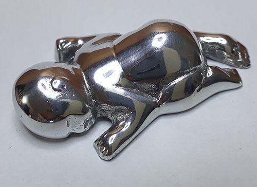 Bebê em alumínio