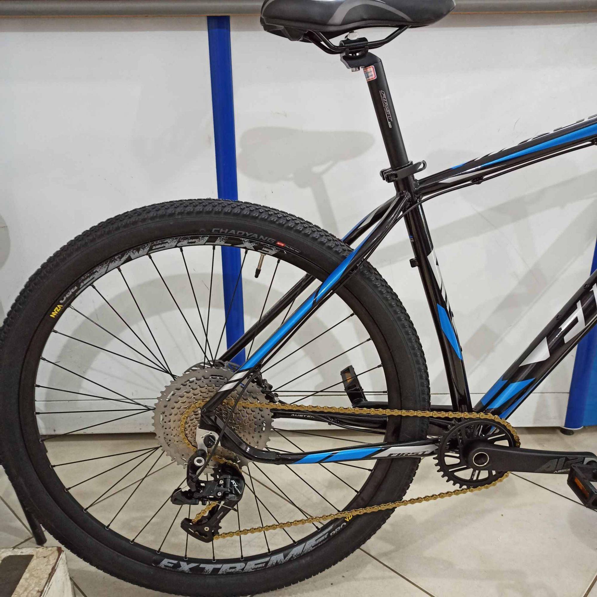 Bicicleta FIRST Austen aro 29 - 12v Ltwoo - Freio Shimano Hidráulico - Suspensão GTA trava no Guidão