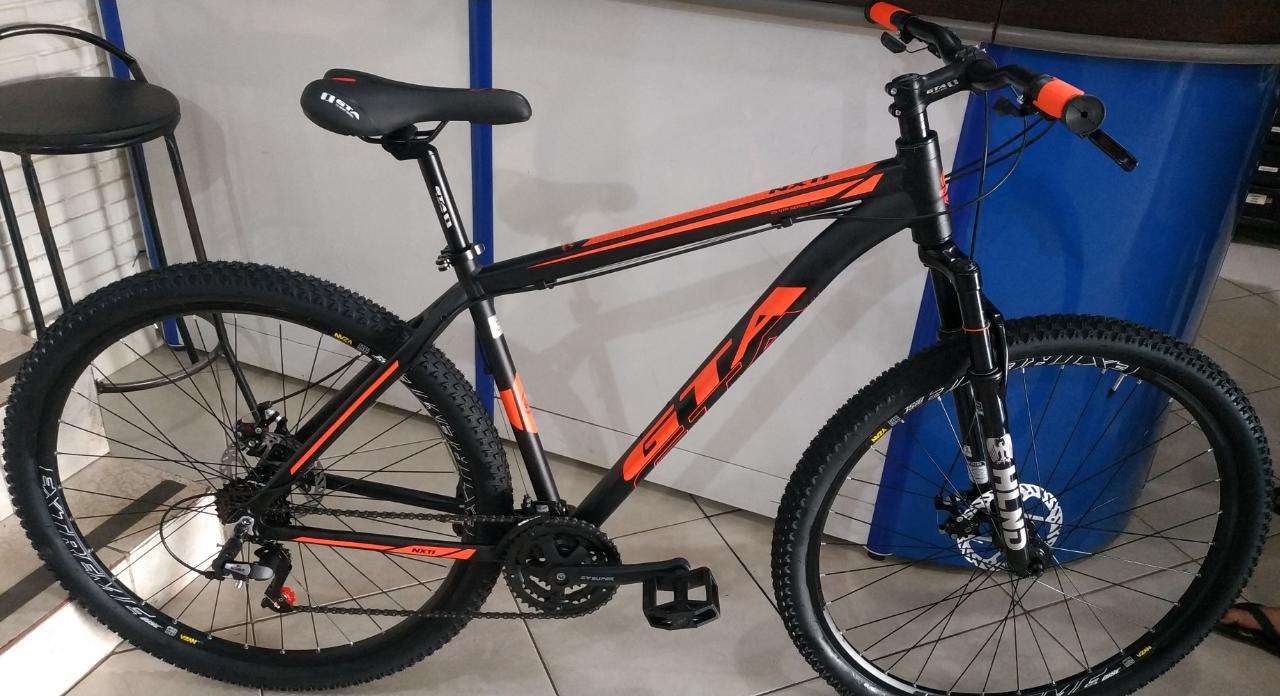 Bicicleta GTA NX11 aro 29 - 21v Sunrun - Freio a Disco Mecânico - Suspensão HLND XC 20