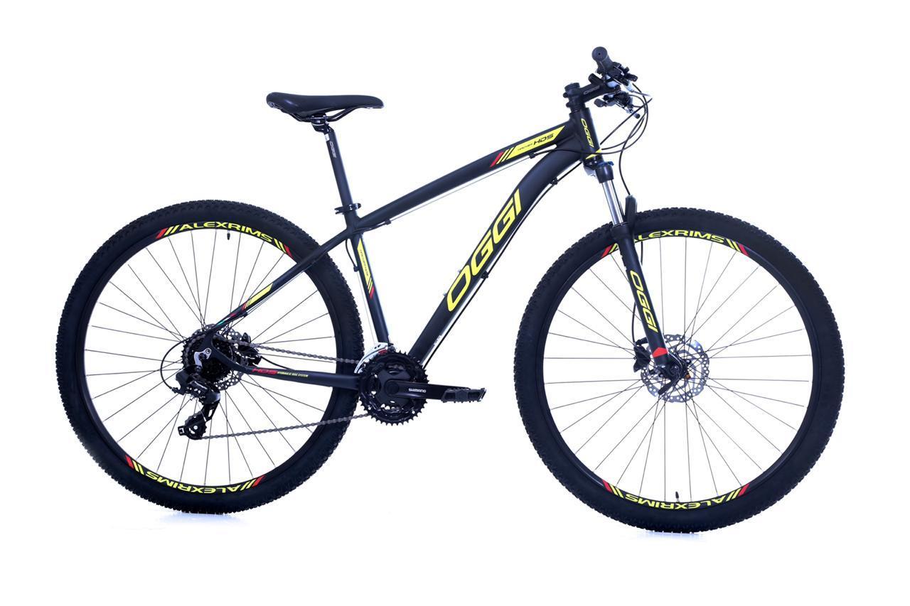 Bicicleta OGGI Hacker HDS - 24v Shimano Tourney - Freio Shimano Hidráulico - PTO/AMAR/VERM + BRINDES