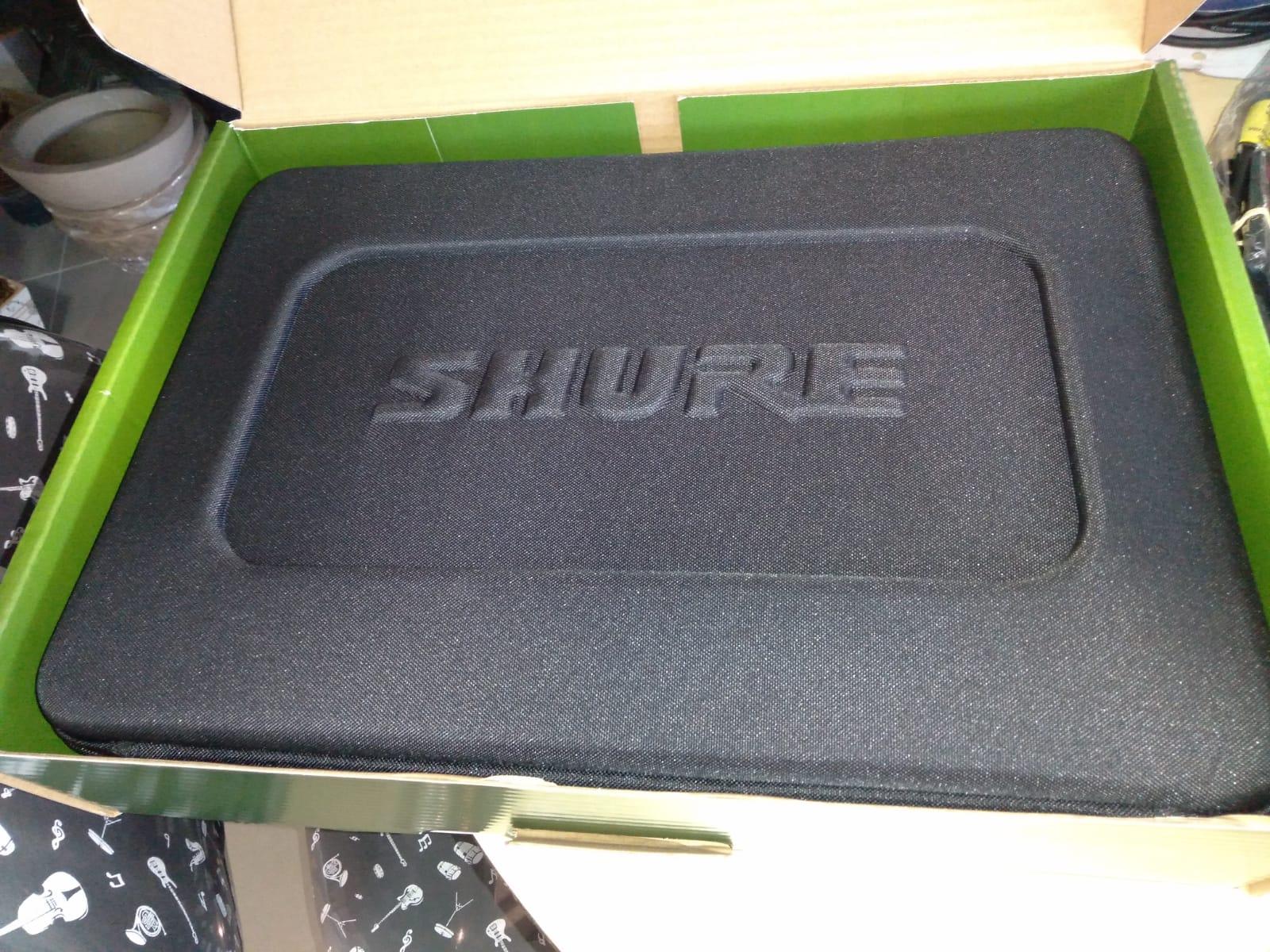 MICROFONE SHURE BLX24 SM58 MAO S/FIO  - Luggi Instrumentos Musicais