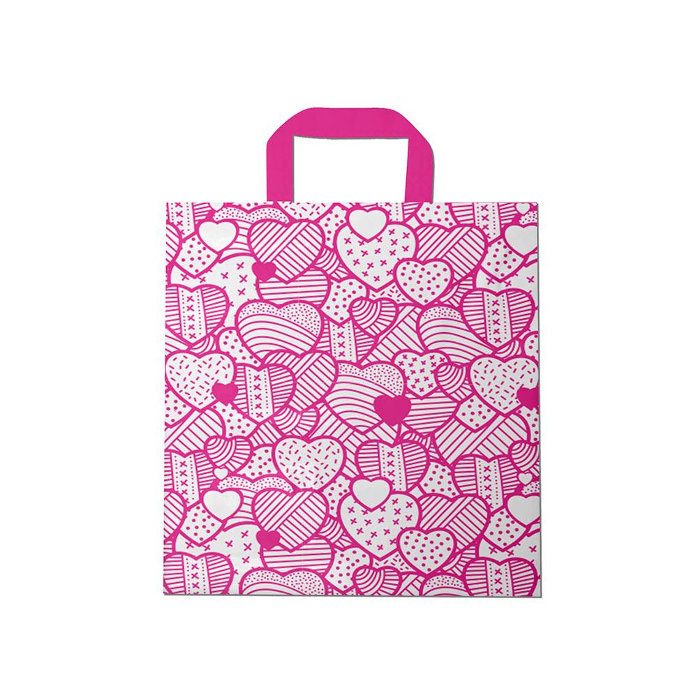 Sacola plástica Alça Fita Estampada - Coração Bco/Pink - 40x40cm - Pacote 30 unid (1 KG)