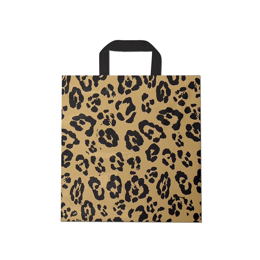 Sacola plástica Alça Fita Estampada - Onça Dourado/Prt - 40x50cm - Pacote 30 unid (1 KG)