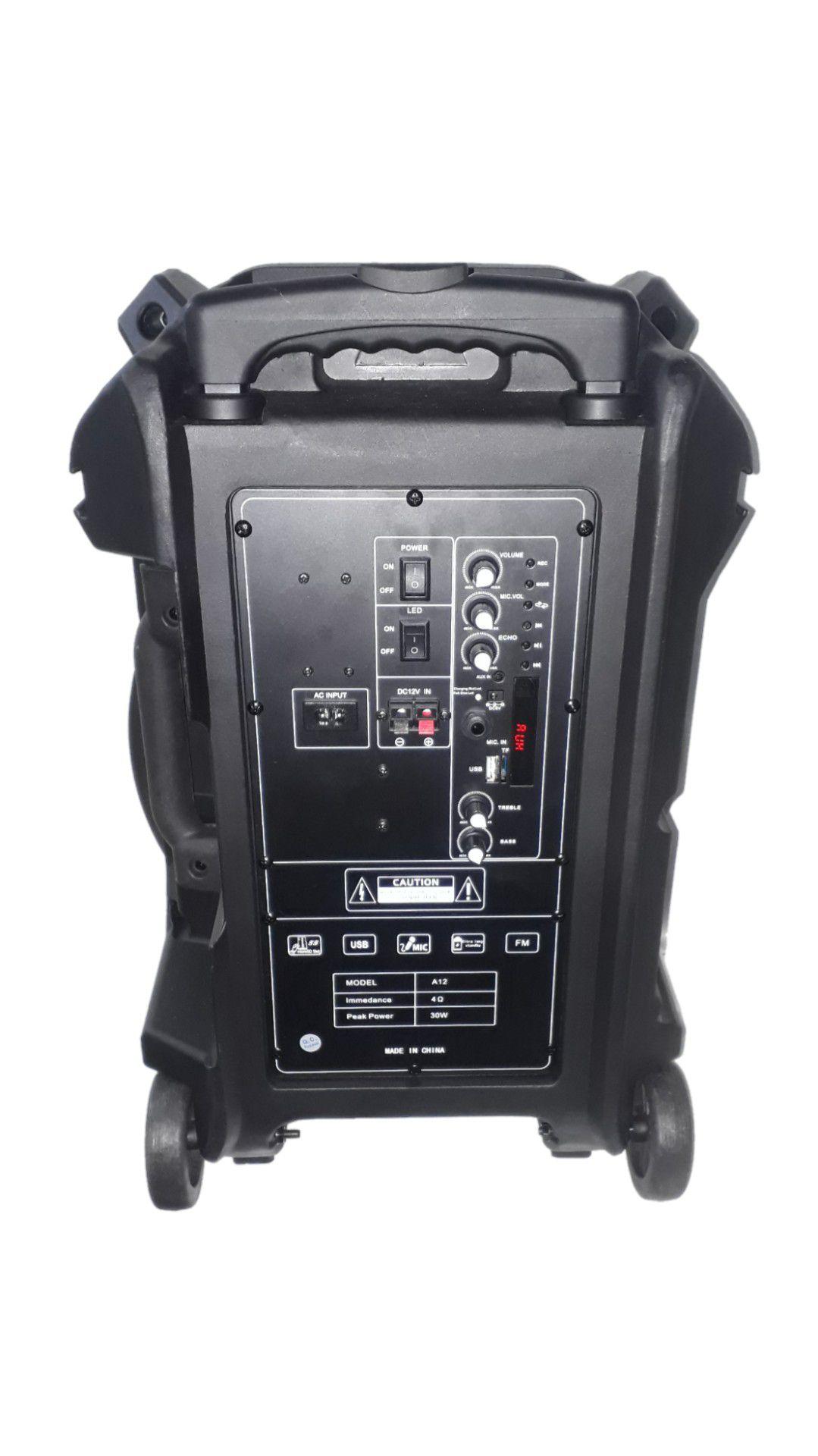 CAIXA AMPLIFICADA  XCELL A12/XC-DWQ BLUE.USB/SD/FM, 2MICROFONES S/FIO,FALANTE12', BATERIA 12V 3 I