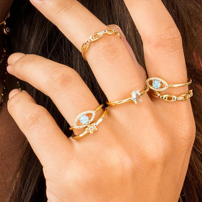 Anel olho grego cravejado pedra azul banho de ouro
