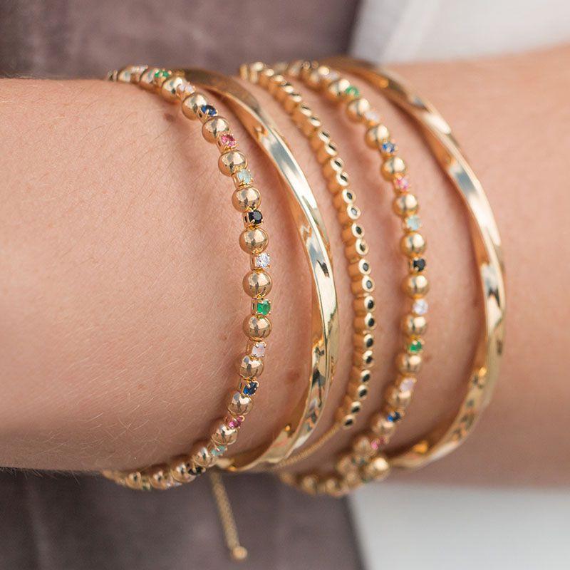 Bracelete bolinhas e zircônias coloridas banho de ouro
