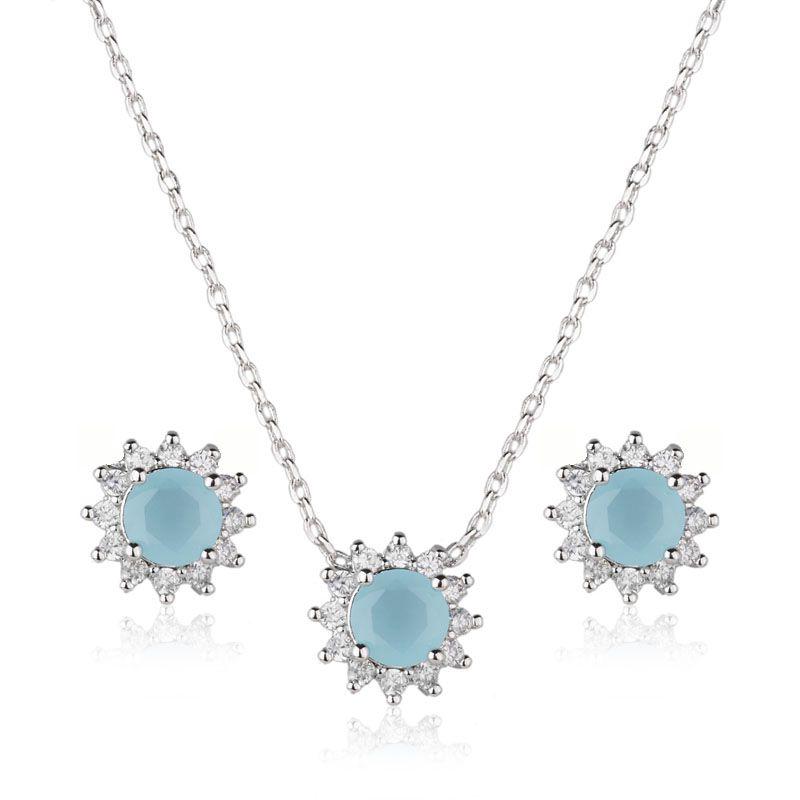 Conjunto flor azul ródio branco