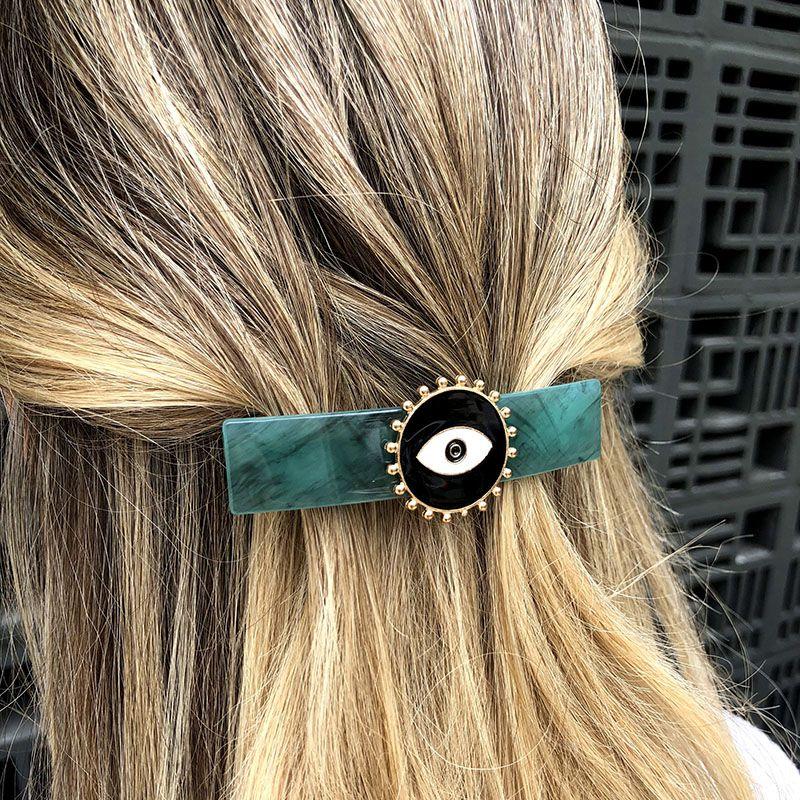 Presilha de cabelo olho grego mesclado turquesa e preto