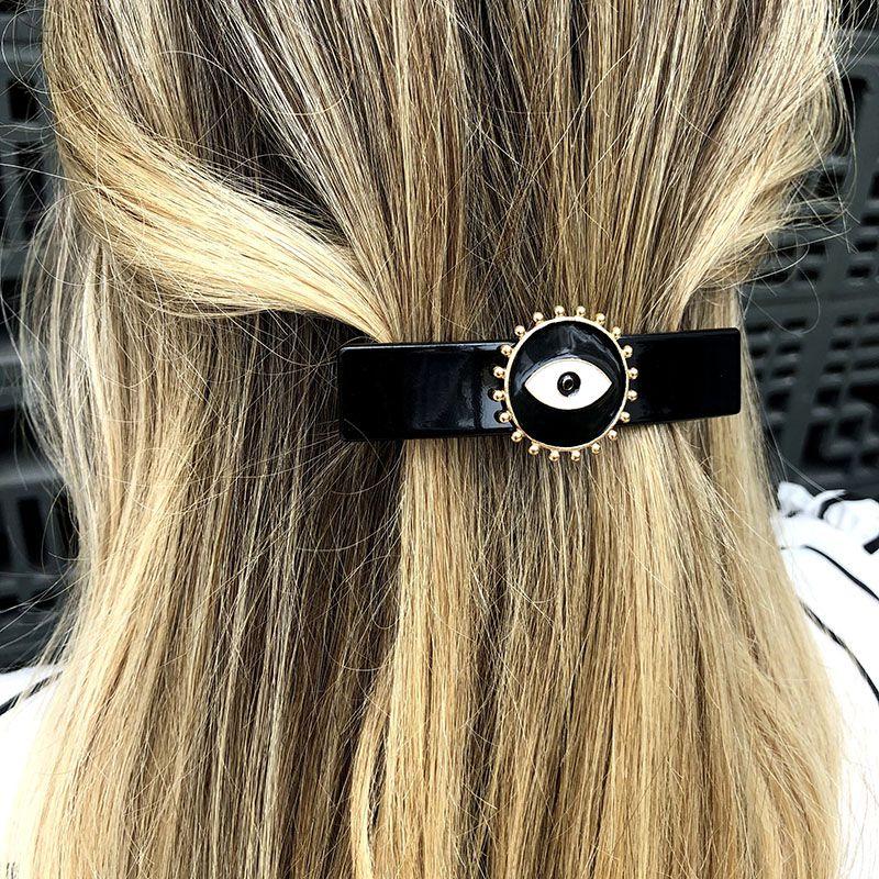 Presilha de cabelo olho grego preto