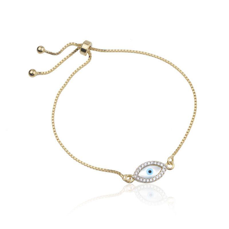 Pulseira olho grego madrepérola cravejada banho de ouro
