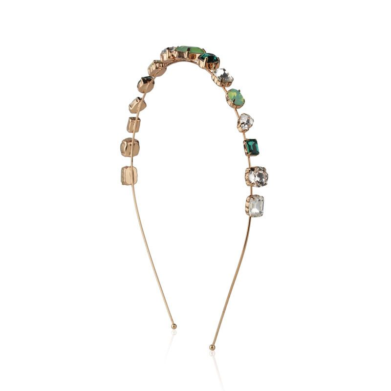 Tiara pedras tons de verde e cristal dourada