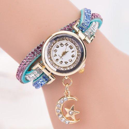 5bf0bb09b7f Relógio de Pulso Feminino - Analógico- Pulseira de Couro - Strass - Lua e  Estrela - Azul Claro