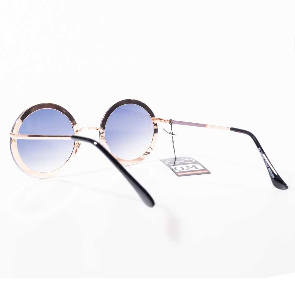 Óculos de Sol Redondo Degradê Detalhes Ilhós Dourado
