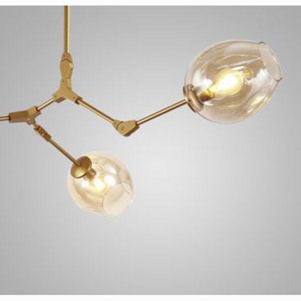 Lustre Orbe Connettori Dourado e Vidro Conhaque Ø69,5cm Mais Luz