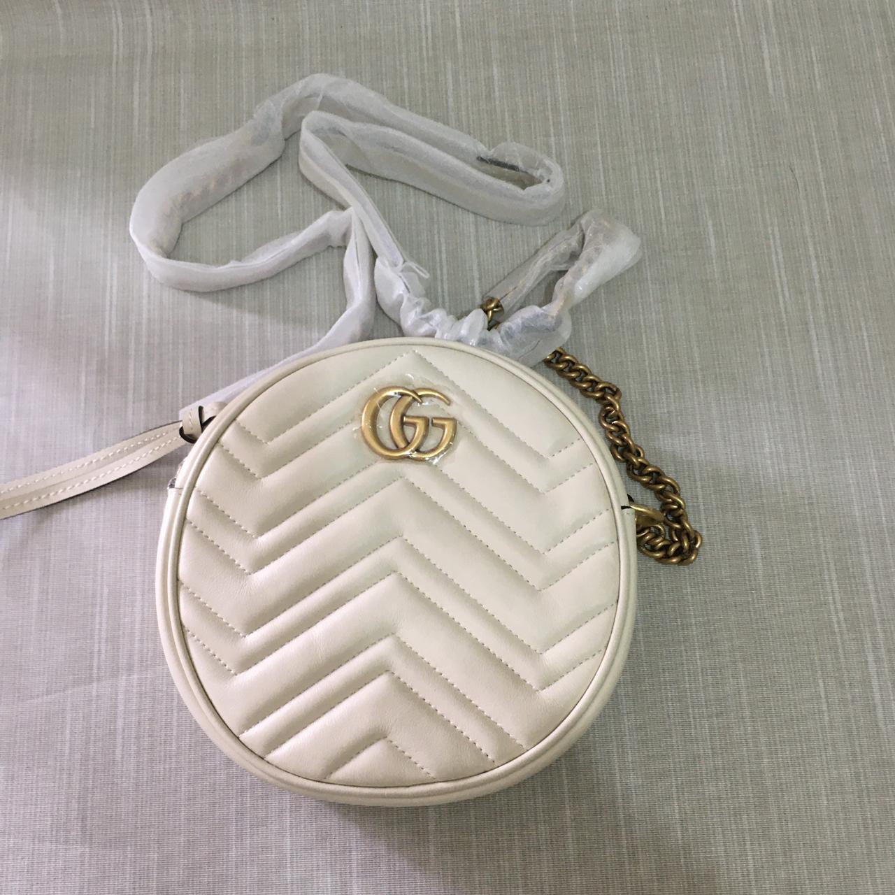 Bolsa Gucci GG Marmont Round