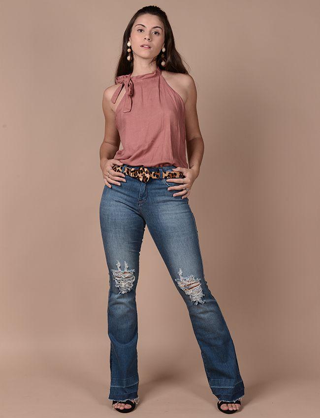 2531a2b83160 Calça jeans flare com fenda
