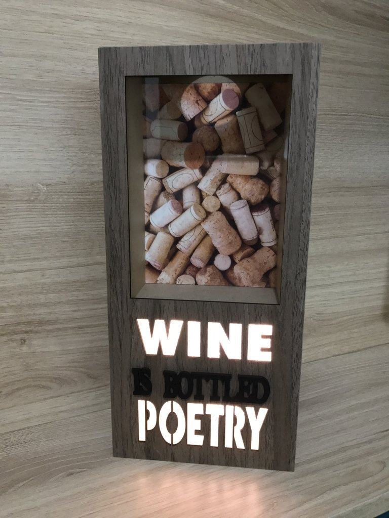 Quadro porta Rolha - Wine is Bottled Poetry