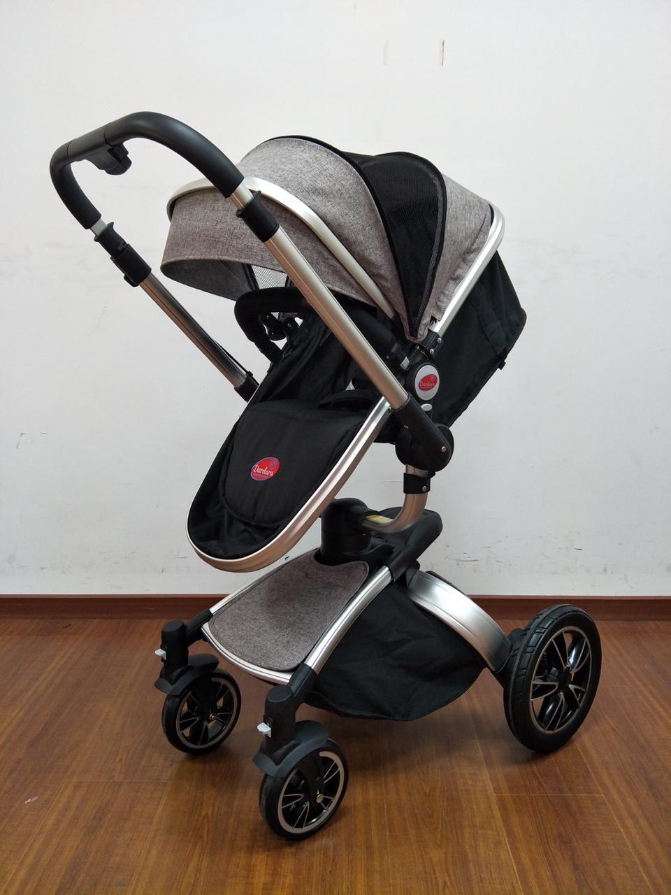 Carrinho de Bebê Giro 360º C/ Bebê Conforto - Cinza