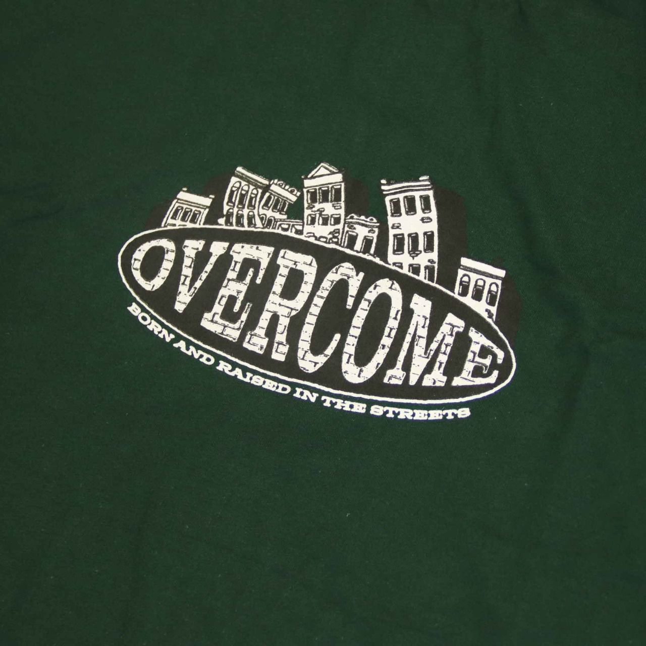 "Camiseta Overcome ""Born In Streets"" Verde"