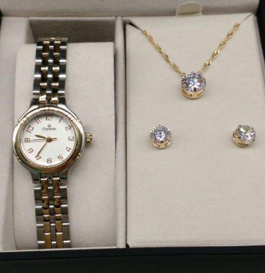 9b16c1a7bda KIT Relógio Champion Pequeno Aço Prata Detalhes em Dourado Visor Branco  CN25387D - BRINDE