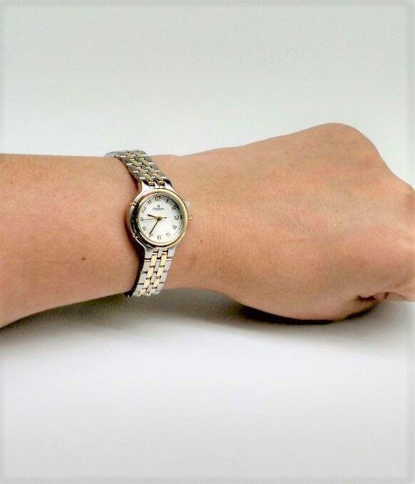 13a83501b0b ... KIT Relógio Champion Pequeno Aço Prata Detalhes em Dourado Visor Branco  CN25387D - BRINDE