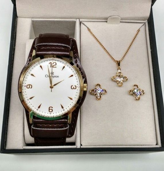 1cef57b8f05 KIT Relógio Champion Feminino Dourado Visor Branco Pulseira Couro CN20328W-  BRINDE