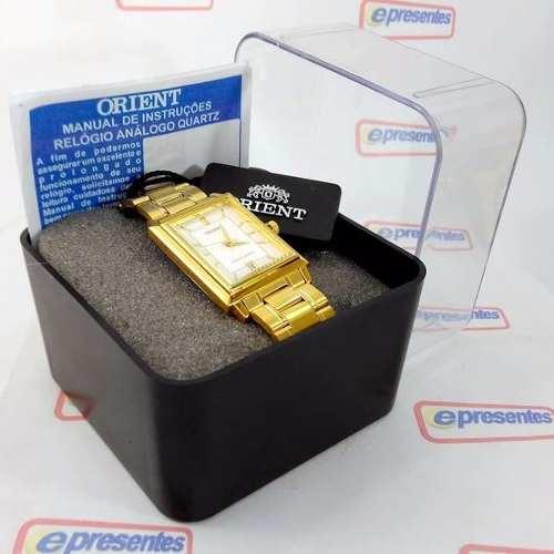 Relógio Orient Dourado Fundo Branco Quadrado FUNAX004W0  - Alexandre Venturini