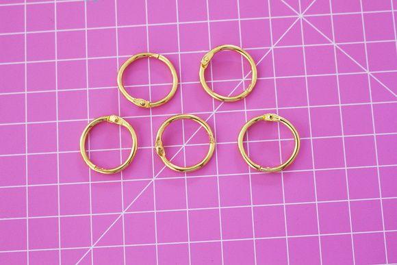 Argola de metal articulada - Dourada